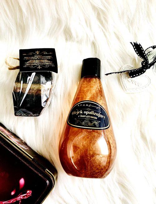 Dwa kosmetyki naturalne z bursztynem i węglem aktywnym czyli mydełko i olejek do ciała.